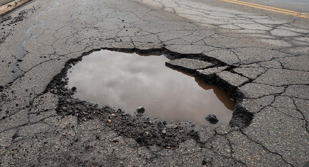 Pot hole in the middle of the road.