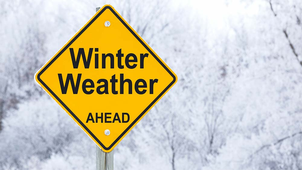 Road sign that says Winter Weather Ahead.
